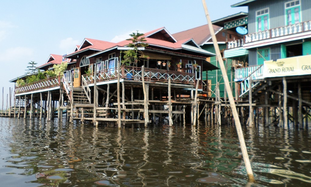 Polluted dark-brown waters of Inle Lake where restaurants and hotels are causing as much damage as proliferating housing needs of the local population.