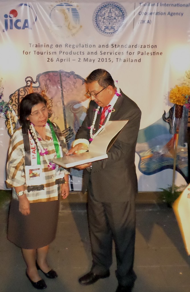 Mr Ali Abusrour presenting Mrs Wannasiri Morakul, Deputy DG of the Department of Tourism, Ministry of Tourism & Sports, with a coffee table book on Palestine.
