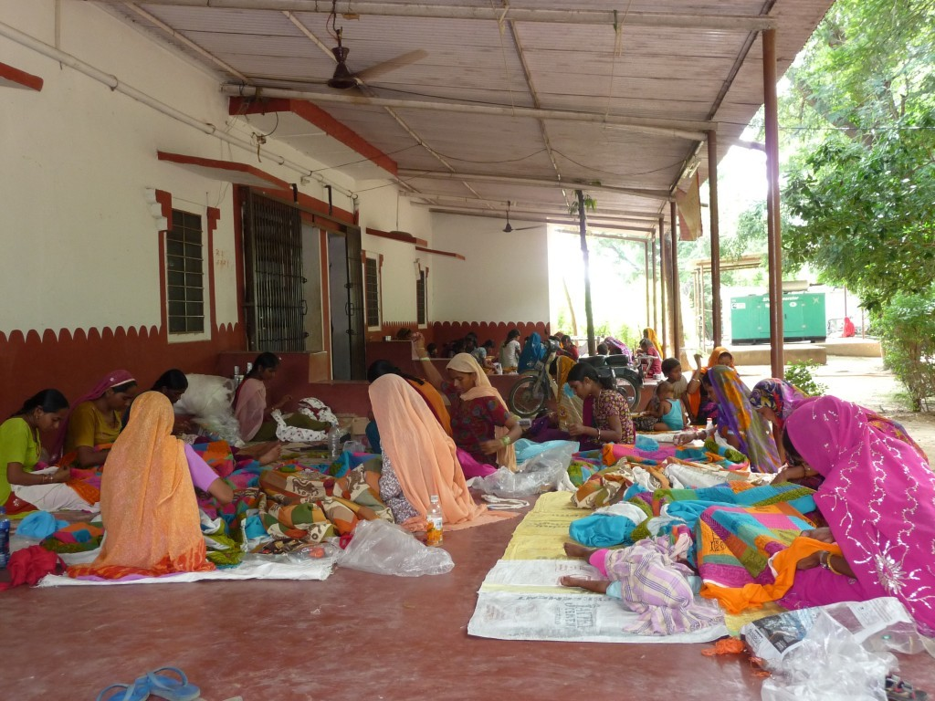 Women in Rajasthan working on hand-embroidered quilts in co-operatives