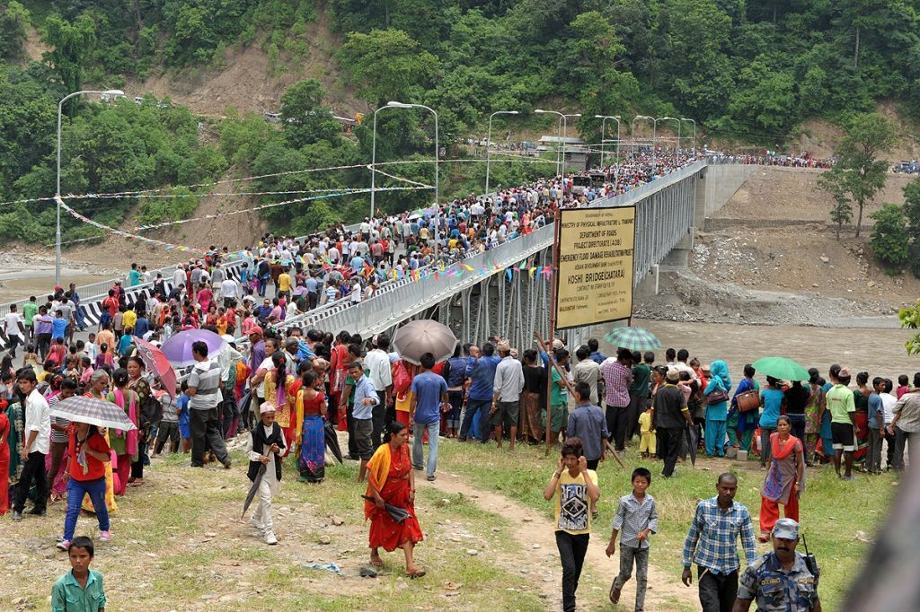 The bridge was built with financial assistance from ADB as an alternative to the Koshi Barrage which was badly damaged by the monsoon floods of 2008. Crowd at the opening of the newly built bridge.
