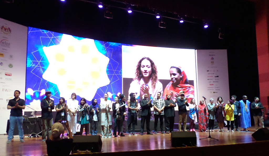 Performers at the evening concert. Seen on the screen are American tabla player Suphala (left) and Mauritanian singer Noura Mint Seymali.