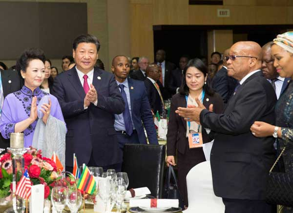 Chinese President Xi Jinping (2nd L F) and his wife Peng Liyuan (1st L F) attend a welcome banquet for the summit of the Forum on China-Africa Cooperation in Johannesburg, South Africa, Dec. 3, 2015. [Xinhua/Huang Jingwen]