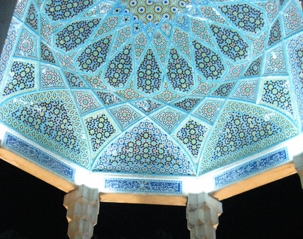 The striking engravings which adorn the ceiling of Hafez' tomb.