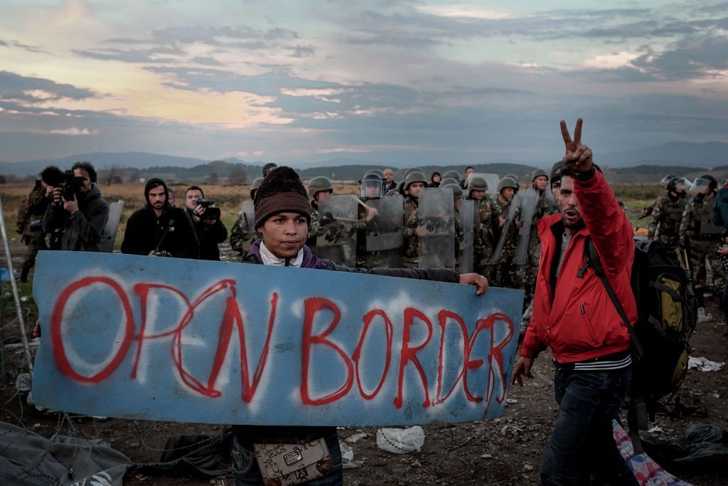 In November 2015, refugees and migrants protest border restrictions near the Greek town of Idomeni, close to the border with the former Yugoslav Republic of Macedonia. Photo: UNICEF/Ashley Gilbertson VII