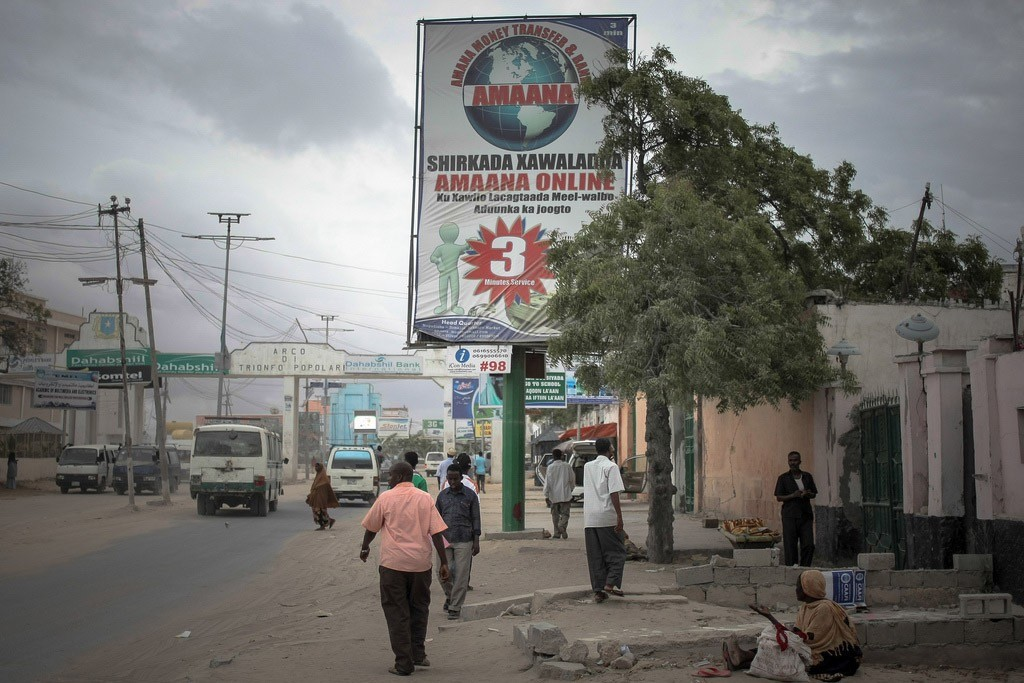Billboards displaying advertisements for international money transfer companies seen in Mogadishu, capital of the Horn of Africa nation Somalia. Photo: AU/UN IST/Stuart Price