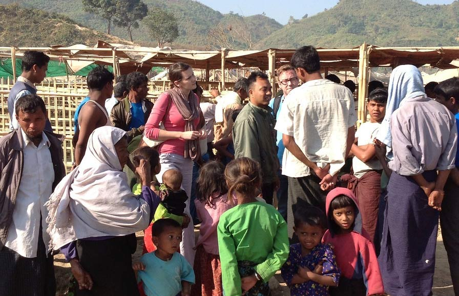 An assessment team talks to displaced people in Pauktaw camp in rural Rakhine, Myanmar, where more than 20,000 Rohingya live. Photo: OCHA/Kirsten Mildren