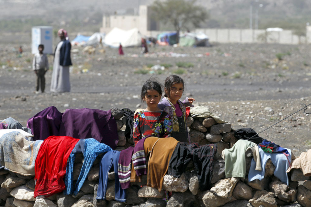 In Yemen, internally displaced children stand outside their family tent after the family fled their home in Saada province and found refuge in Darwin camp, in the northern province of Amran. PhotO: UNHCR/Yahya Arhab