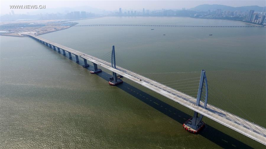 Towers of the world's longest cross-sea bridge, which connects Zhuhai in Guangdong Province with Hong Kong and Macao, are seen in Zhuhai, south China's Guangdong Province, Sept. 27, 2016. A ceremony was held Tuesday in Zhuhai to celebrate completion of the 55-km cross-sea route and beginning of the assembly of the bridge floor and related work. (Xinhua/Liang Xu)